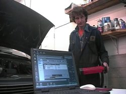 Henry with laptop OBD scan tool connected to 97 Chev Astro Van, retrieving DTC engine data for graphed output on PC